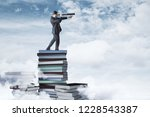 curios businessman standing on... | Shutterstock . vector #1228543387