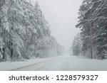 snowfall in the countryside... | Shutterstock . vector #1228579327
