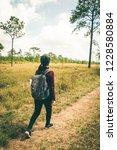 women tourists walk in the... | Shutterstock . vector #1228580884