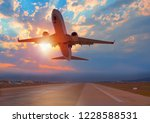 airplane taking off from the... | Shutterstock . vector #1228588531