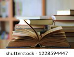 close up of old book opened on... | Shutterstock . vector #1228594447