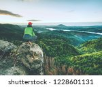 man stands alone on the peak of ... | Shutterstock . vector #1228601131