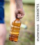 beer in a plastic bottle in... | Shutterstock . vector #1228608751