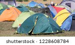 camping of tents in a field in... | Shutterstock . vector #1228608784