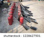red tank of fire extinguisher.... | Shutterstock . vector #1228627501