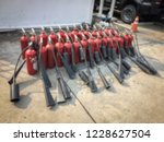 red tank of fire extinguisher.... | Shutterstock . vector #1228627504