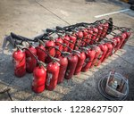 red tank of fire extinguisher.... | Shutterstock . vector #1228627507