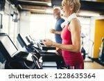 senior people running in... | Shutterstock . vector #1228635364