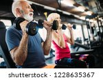 fit senior sporty couple... | Shutterstock . vector #1228635367