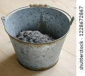 Ash In A Metal Bucket.