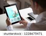 bussinessman at office holding... | Shutterstock . vector #1228675471