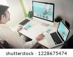 man working with devices with... | Shutterstock . vector #1228675474