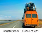 an old minibus is used to move... | Shutterstock . vector #1228675924
