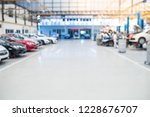 car raised on car lift in auto... | Shutterstock . vector #1228676707
