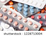 heap of colorful round capsule... | Shutterstock . vector #1228713004