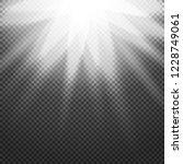 shiny sunburst of sunbeams on... | Shutterstock . vector #1228749061
