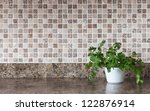 Stock photo white pot with green herbs on kitchen countertop 122876914