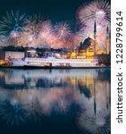 beautiful fireworks above pier  ... | Shutterstock . vector #1228799614