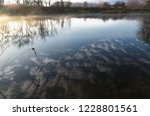 the water which reflects the... | Shutterstock . vector #1228801561