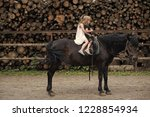 girls ride on horse on summer... | Shutterstock . vector #1228854934
