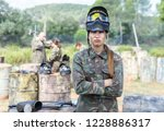 female paintball player in... | Shutterstock . vector #1228886317