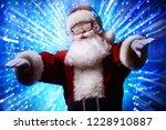dj santa claus in snowy glasses ... | Shutterstock . vector #1228910887