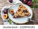 piece of plum cake on a plate...   Shutterstock . vector #1228944181