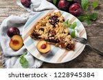 piece of home made plum cake on ...   Shutterstock . vector #1228945384