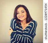 happy woman hugging herself...   Shutterstock . vector #1228971454