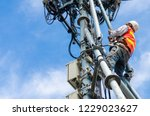 technician working on high... | Shutterstock . vector #1229023627