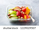 fruits salad and nuts in a... | Shutterstock . vector #1229029507