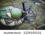 soldier reloads machine gun ... | Shutterstock . vector #1229105131