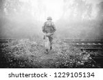 soldier at the railroad tracks | Shutterstock . vector #1229105134