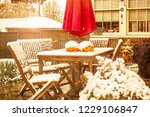 early snow   outdoor table and... | Shutterstock . vector #1229106847