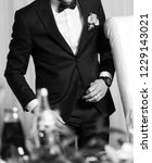 groom black white portrait.... | Shutterstock . vector #1229143021