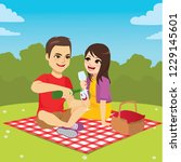 cute young couple on picnic day ... | Shutterstock .eps vector #1229145601