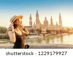 happy traveler in hat on the... | Shutterstock . vector #1229179927