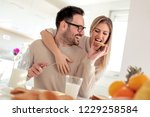young happy couple sitting in... | Shutterstock . vector #1229258584