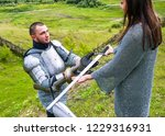 a lady in a chain mail hands a... | Shutterstock . vector #1229316931