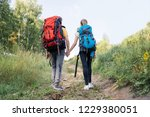 couple of tourists with... | Shutterstock . vector #1229380051