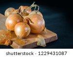 onions on wooden board   Shutterstock . vector #1229431087