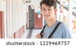 caucasian boy in school hallway.   Shutterstock . vector #1229469757