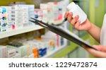 pharmacist holding medicine... | Shutterstock . vector #1229472874