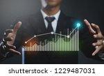 businessman creating growing... | Shutterstock . vector #1229487031