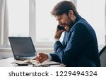 man talking on the phone at the ... | Shutterstock . vector #1229494324