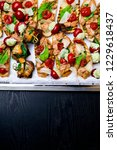 bruschettas on metal tray flat... | Shutterstock . vector #1229618437