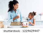 african american mother and... | Shutterstock . vector #1229629447