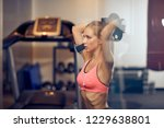woman working out with weight... | Shutterstock . vector #1229638801