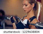 close up of woman lifting... | Shutterstock . vector #1229638804