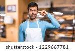 man wearing an apron making the ... | Shutterstock . vector #1229667781